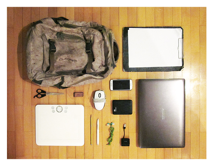 Freelance Artist's Travel Kit. Laptop, hard drive, pen tablet, smartphone, paper, pencil, mouse, earbuds and a backpack.